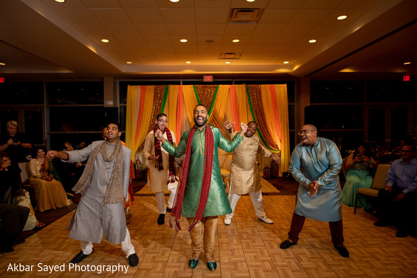 Indian groom dancing with his groomsmen capture.