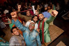 Joyful Indian groomsmen with groom's capture.