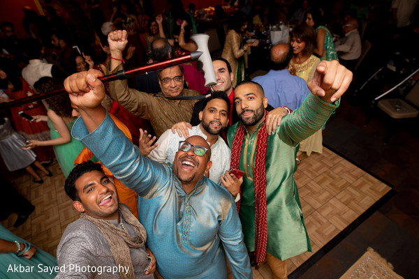 Joyful Indian groomsmen with groom's capture.