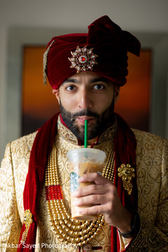 Indian groom getting an iced coffee.