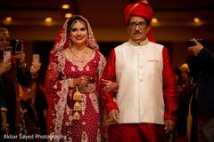 Glamorous Indian bride entering her wedding ceremony.