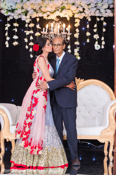 Dazzling indian bride with father photography.