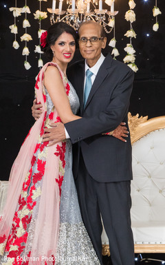 Lovely Indian bride posing with father.