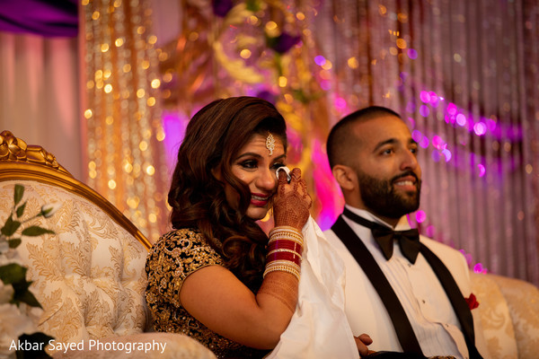 Sweet Indian couple at their reception capture.