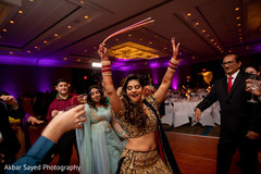 Sweet indian bride dancing at reception party.