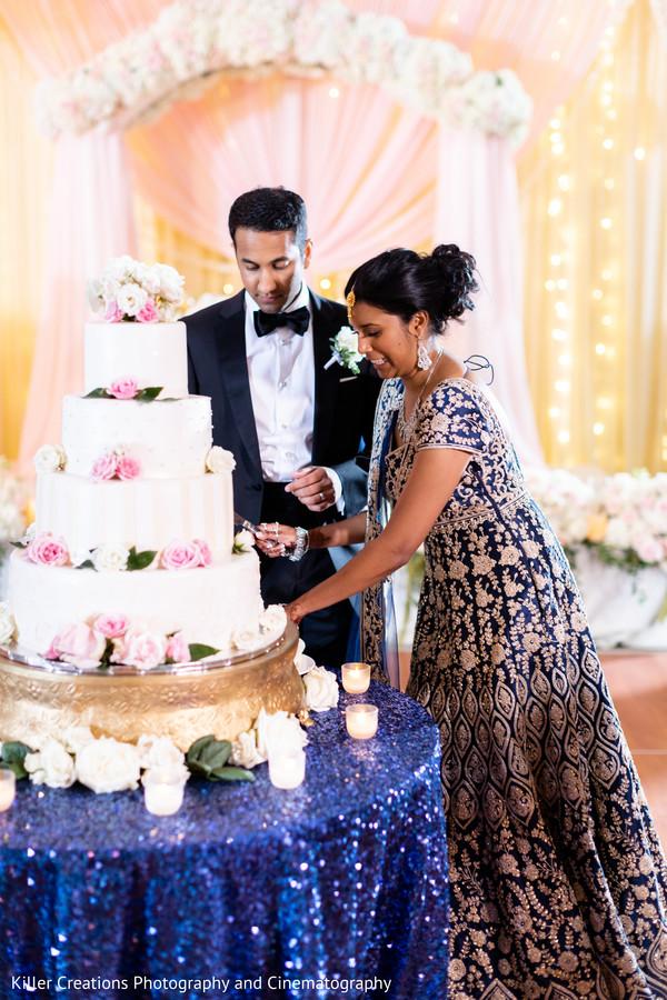 Indian bride cutting the wedding cake