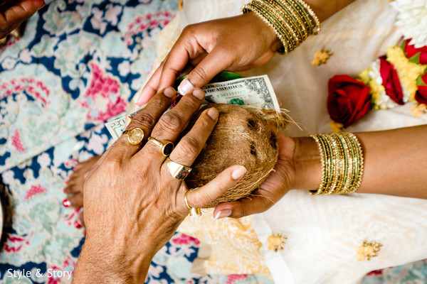 Closeup capture of the coconut pre-wedding ritual.