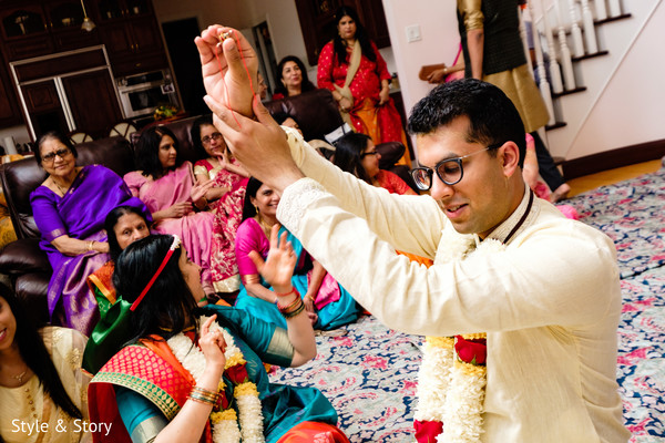 Indian groom holding bride's brazalete.