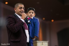Indian groom with kid delivering a speech