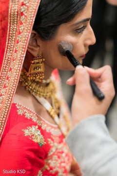 Beautiful Maharani being assisted by makeup artist
