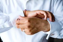 Indian groom getting his cufflinks capture.