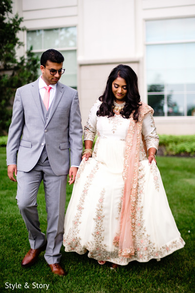 Lovely Indian  bride and groom walking.