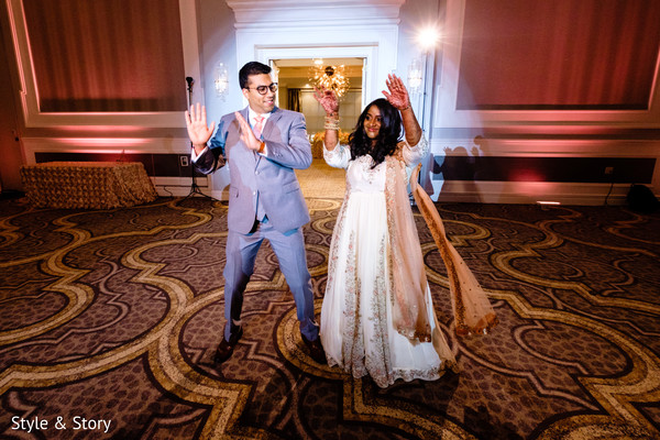 Ravishing Indian bride and groom making their entrance to reception.