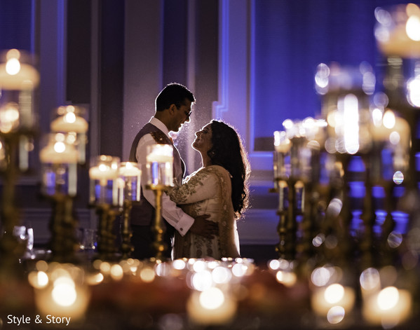 Charming Indian bride and groom wedding reception fashion look.