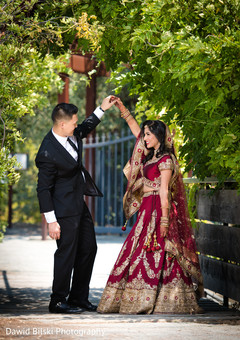 Dazzling capture of Indian bride and groom outdoors