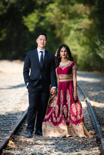 Indian bride and groom glowing in her wedding attire.