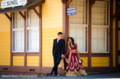 Indian couple outdoors taking pictures