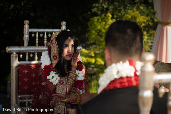 Indian bride wearing the flower garland