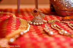 Golden Indian bridal earring closeup capture.