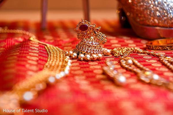 Golden Indian bridal earring closeup capture.
