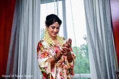 Happy maharani getting her jewelry on.