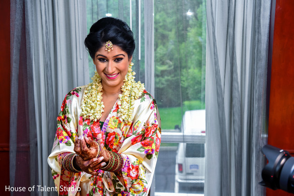 Lovely Indian bride wearing her Tikka and  bangles.