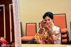 Indian bride showing her Parvathi nose ring.
