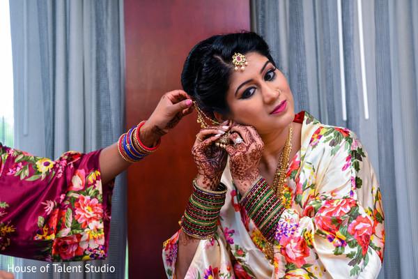 Maharani getting her earrings on.