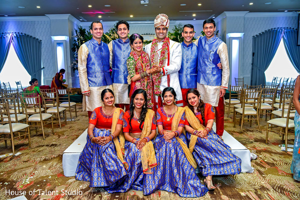 Indian lovebirds with bridesmaids and groomsmen photo.