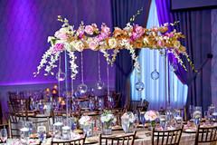 Graceful Indian wedding floral table centerpiece decoration.