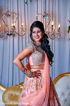 Elegant Indian bride wedding reception fashion.