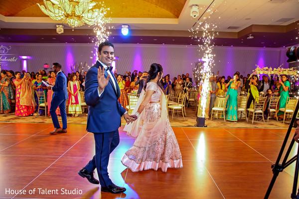 indian bride and groom,indian wedding dance floor,lights decor