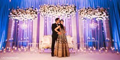 See this lovely Indian couple at their wedding reception.