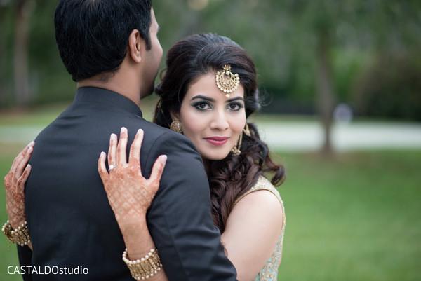 Elegant Indian bride and groom sangeet fashion.