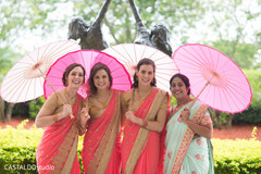 Sweet Indian bridesmaids posing for photo shoot.