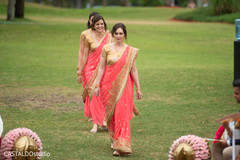 Indian bridesmaids entrance to wedding ceremony.
