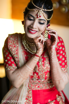 Charming indian bride getting ready scene.