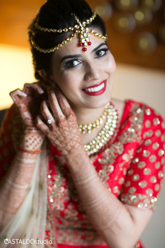 Dazzling indian bride getting ready.