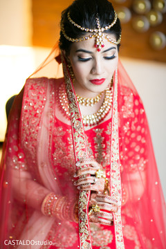 Indian bride with her traditional red Ghoonghat.