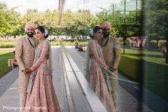 Indian newlyweds taking pictures outside