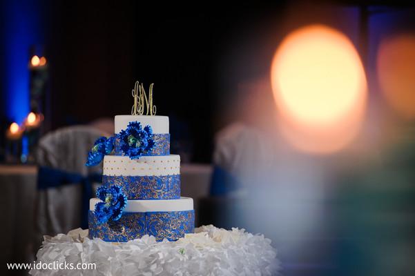 Wonderful Indian wedding cake personalized letters lights decor.