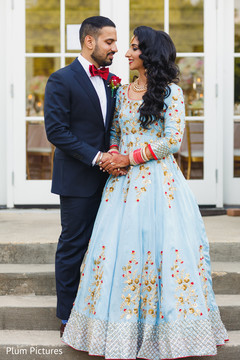 Lovely Indian couple in their reception outfits.