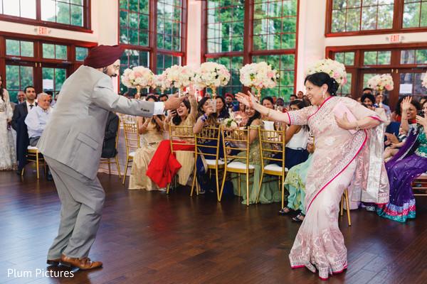 Joyful Indian wedding dance capture.
