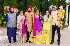 Gorgeous Indian bride and groom posing outdoors with family.