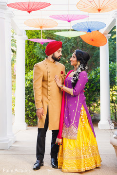 Gorgeous Indian bride and groom's sangeet outfit.