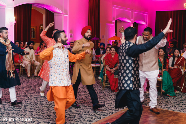 Indian groomsmen entrance to sangeet party.