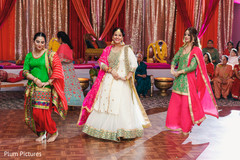 Gorgeous Indian bridesmaids performing a dance.