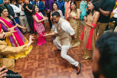 Indian bride and groom with guests sangeet dance.