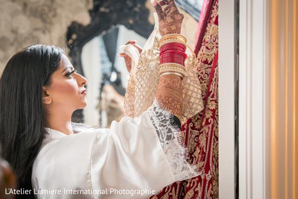 Maharani admiring her open shirt lehenga.