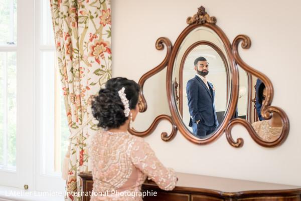 Maharani admiring her maharaja on a mirror.